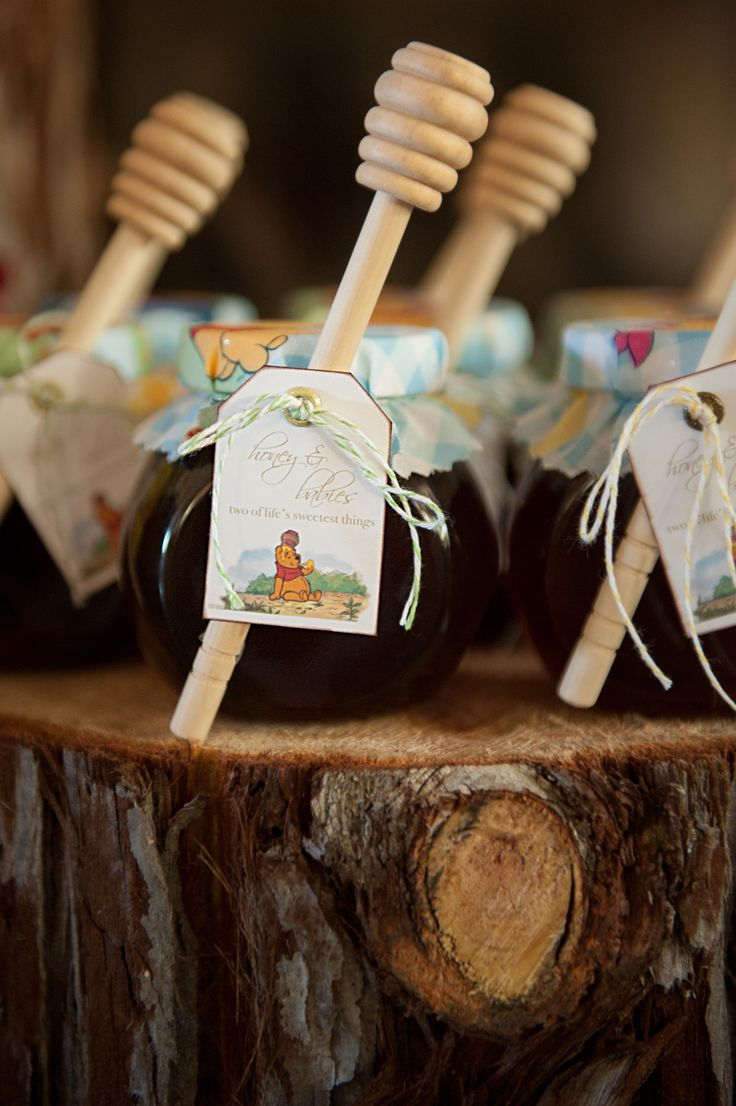 Honey Jar party favors - Winnie the Pooh baby shower.  They're simple to make (jars from IKEA, honey dippers from Amazon and Pooh fabric, custom made tag).  Overall cost was about $3.25 each for the 24 we made for our daughter's guests. Soooo cute! :)