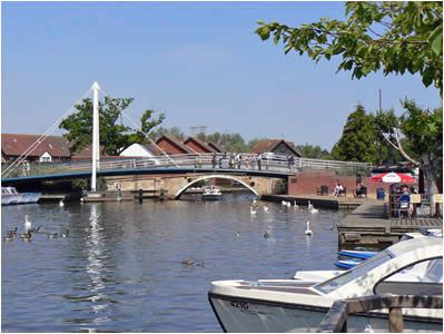 Wroxham Bridge - hours of fun spent as a child watching tourists rip the tops off their hired boats trying to get under the bridge after ignoring the warnings...