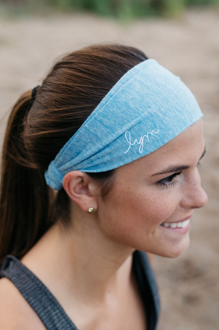 This tri-blend light blue headband is perfect for a casual day or your hardest workout. It has a flat front with the lym cursive logo embroidered in white and a scrunchy back to fit any size melon. Fi