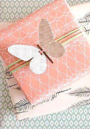 lovely use of a paper butterfly instead of a bow on this gift wrapping.