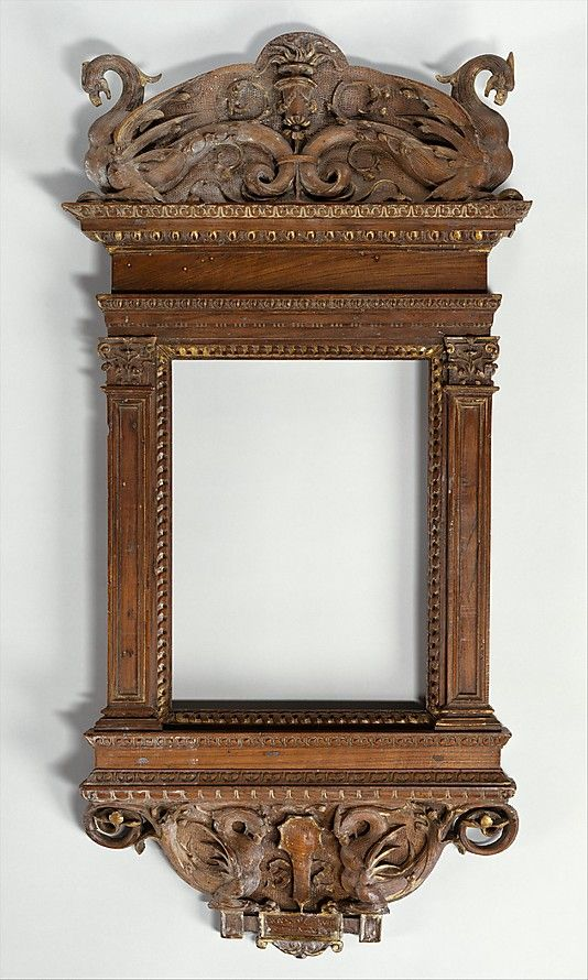 "Italian mirror frame, c. 1530. ""An inscription warning against vanity, ""Not beauty but truth is to be admired,"" appears in the cartouche below two griffins at the bottom edge of this carved frame that originally housed a mirror. The mirror would have been covered with a sliding shutter (now lost). The style of the frame and the quality of its craftsmanship suggest that this was made in the del Tasso workshop in Florence, which for 3 generations was famous for its woodcarving."" - Met website."