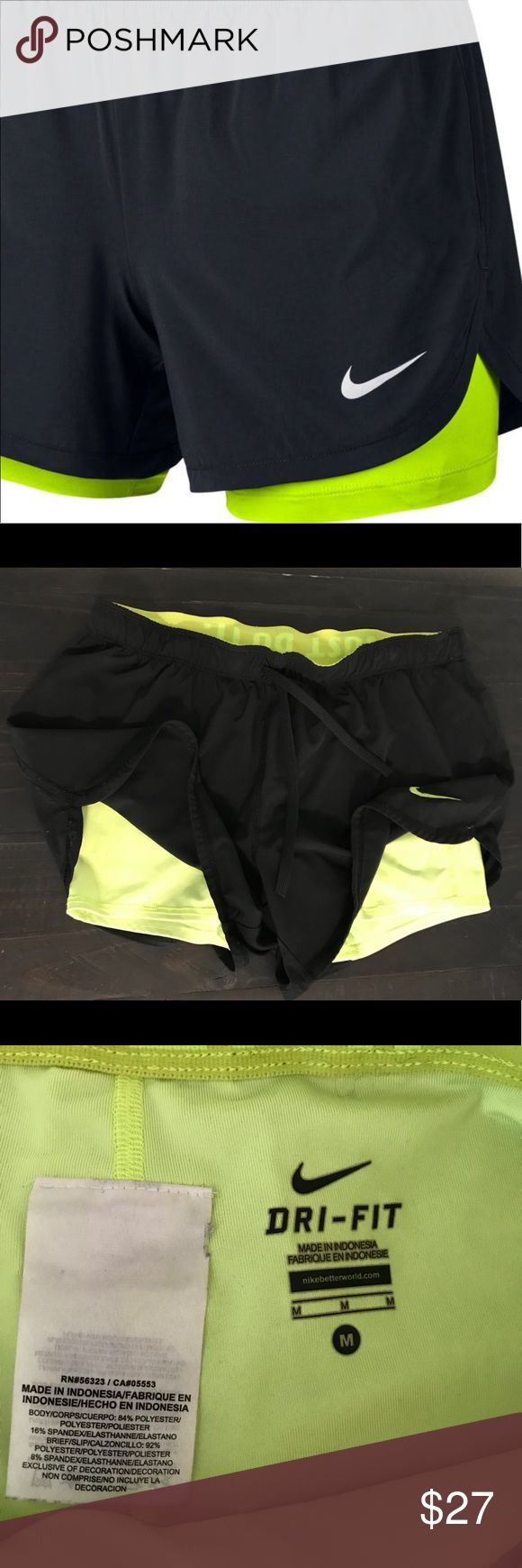 Nike Dri Fit 2 in 1 shorts Black loose shorts with elastic neon green shorts underneath. Very comfy only worn a few times. Perfect condition. Nike Shorts
