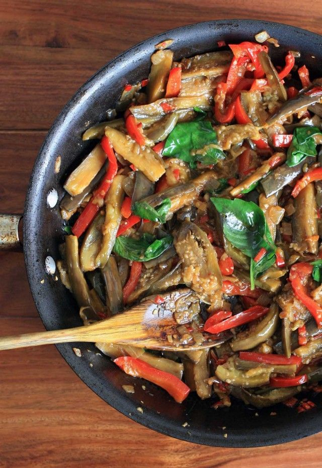 Spicy Thai eggplant with red peppers and Thai basil.