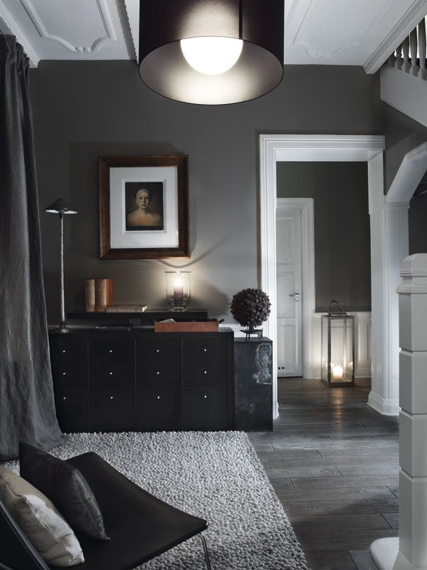 Swedish bedroom with dark gray walls and white washed floors