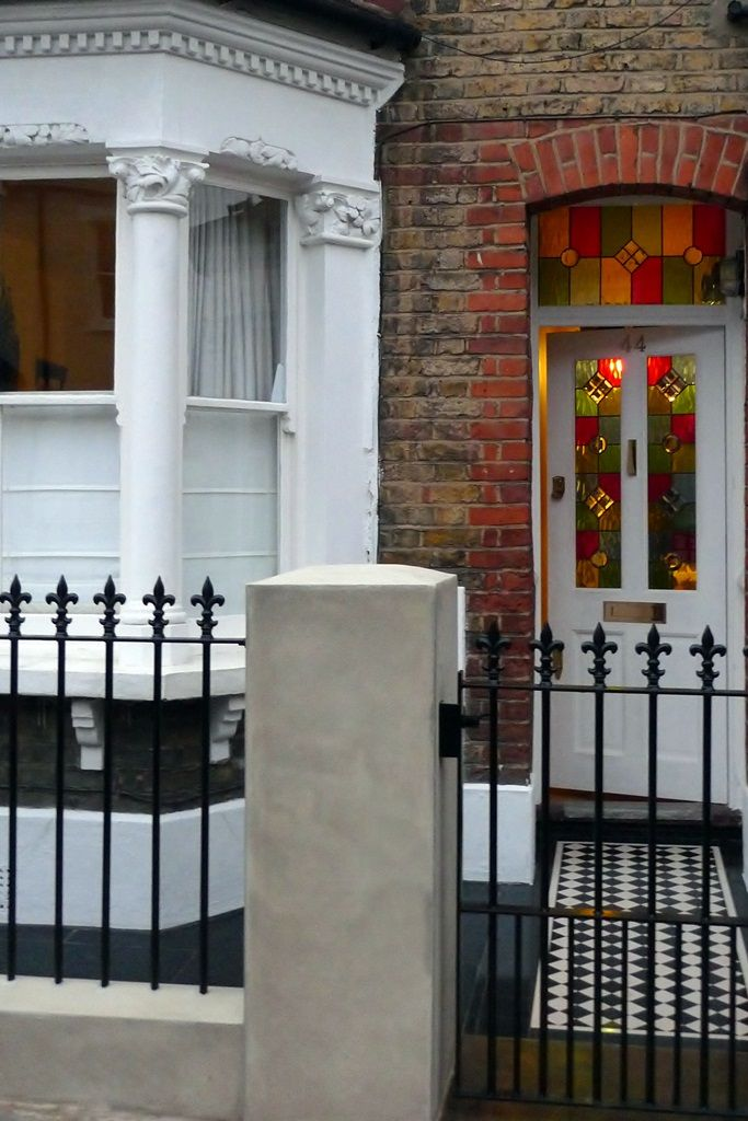 front garden metal gate and rail london with natural render