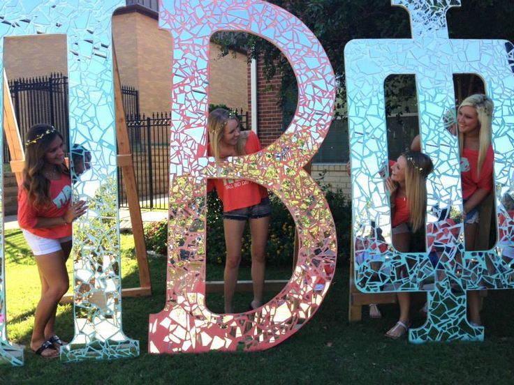broken glass glued to large letters that were painted before hand. too cute! we should do this for dz
