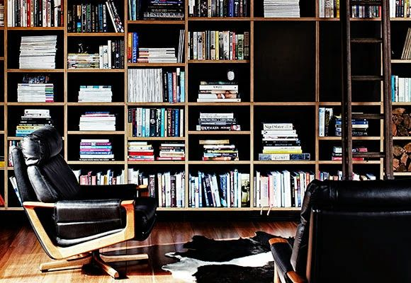 The Design Chaser: Homes to Inspire | Converted Lolly Factory - black & ply shelving, floor to ceiling, with ladder...