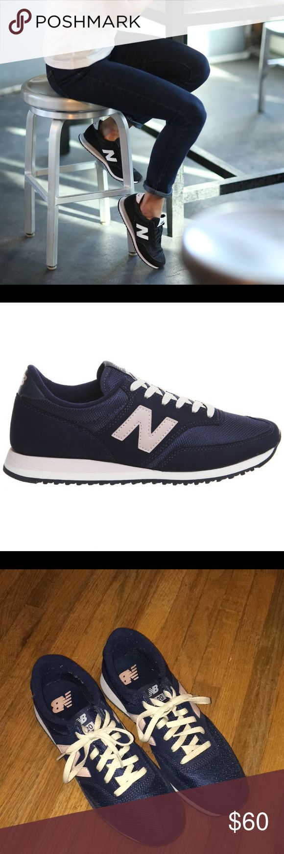 New Balance 620 sneakers Worn twice, purchased from the New Balance Store. These are navy blue with soft pink details and white laces. Very feminine and classic! No flaws besides having been worn a couple times. New Balance Shoes Athletic Shoes