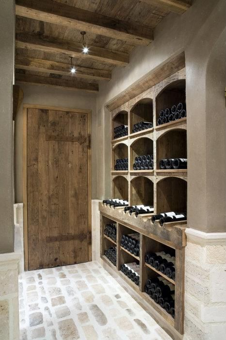 rustic wine room with stone floors, beamed ceiling and custom reclaimed wood. Bourgondisch Kruis - Rustieke bouwmaterialen - Realisaties - Wijnkelder