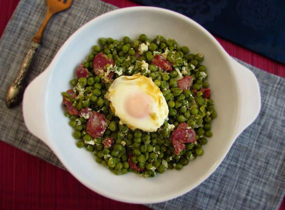 Peas with poached eggs and chorizo   Food From Portugal. A very tasty and nutritious recipe, peas prepared in a sautéed of olive oil, chopped onion, garlics, bay leaf and chorizo, served with poached eggs, sprinkled with coriander. http://www.foodfromportugal.com/recipe/peas-poached-eggs-chorizo/