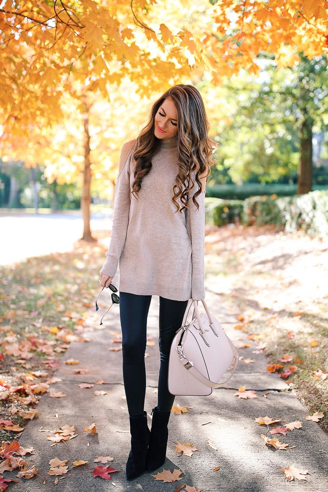 beige sweater and handbag, black faux leather leggings and booties