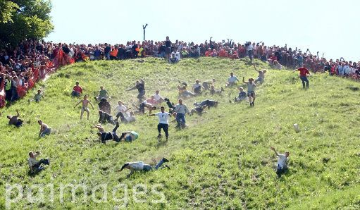 Competitors chase a Double Gloucester cheese down a steep slope, for the ancient daredevil sport. More than 4,000 spectators flocked to the odd event which has been celebrated for centuries and is thought to have its roots in a heathen festival to celebrate the return of spring.