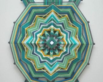 The calming purples, heather grays, and teals of this mandala evoke a feeling of peace, while the red center conveys energy and vitality. Like we as people, this mandala contains contradictions at harmony within one whole. I look forward to recreating this mandala to fit your specifications