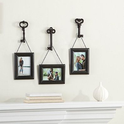 This set of frames features a weathered frame hanging from an antique skeleton key by a black metal chain. This set includes three frames that each come with a different key hand selected from our assorted collection.