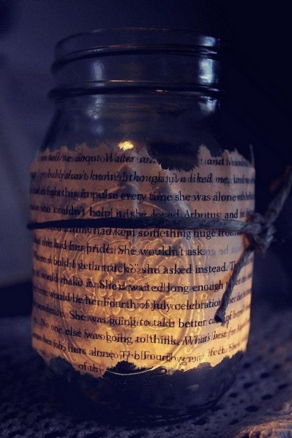 Fab Quirks By Annie    all you need are jars and some old books from an op shop - glue them on tie some twine around it and pop a candle and maybe some water for it to float on and you have another centrepiece idea? kinda looks shipwrecky - holds loosely with a beach theme :)