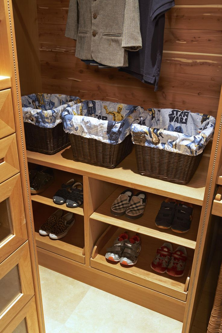 cute boys closet with pine shelves pull out shoe cubbys and glass fronted drawers fun woven baskets lined with star wars fabric