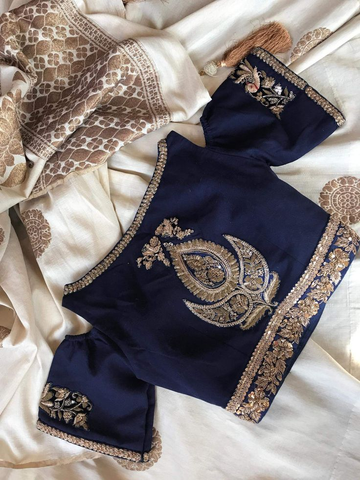 I don't know about you, but I am loving this cold shoulder design! Stunning silk embroidered navy blue silver gold boat neck cold shoulder saree sari lehenga blouse #apoorvatailoring