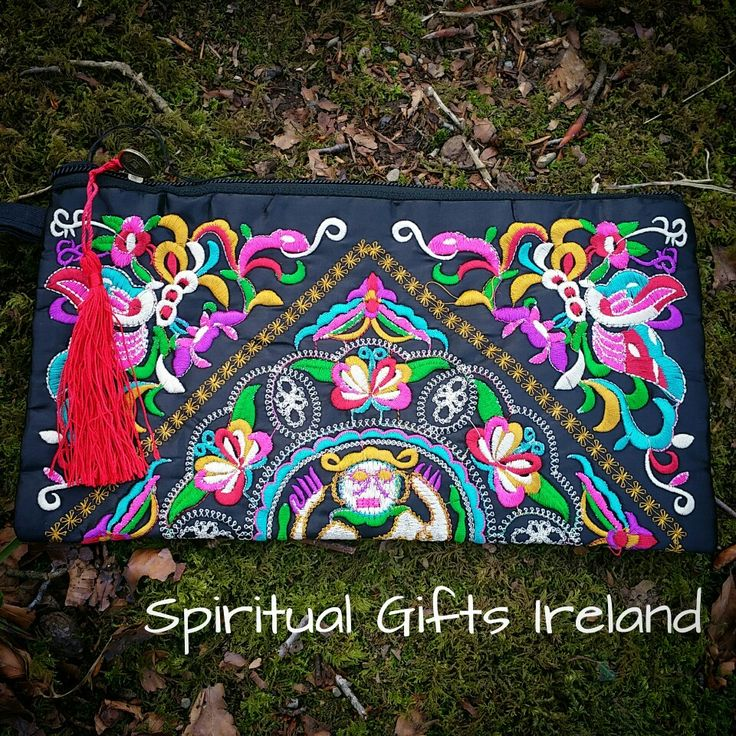 Handmade with coloured threads woven into a magical tapestry design, this gorgeous bag is perfect for keeping all your treasures safe.  Zip fastening with two inner sections. The perfect size for angel cards and crystals. The wristlet strap makes this the perfect companion for a night out without the bulk of a handbag Follow us on : www.facebook.com/spiritualgiftsireland www.instagram.com/spiritualgiftsireland  www.etsy.com/shop/spiritualgiftireland