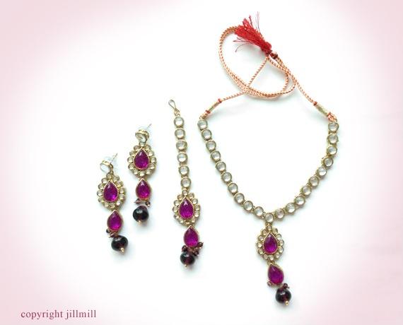 Purple hued teardrop shaped stones and beads light up this piece of single row white Kundans.