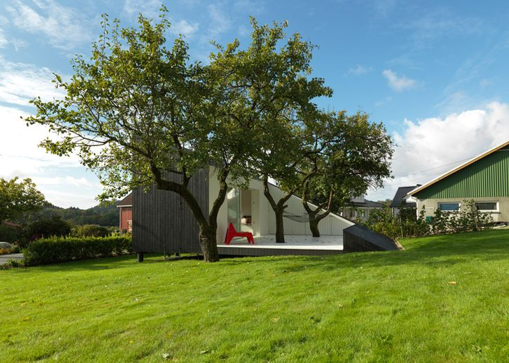 Wedge-shaped cabin by Todd Saunders punctured by a terrace