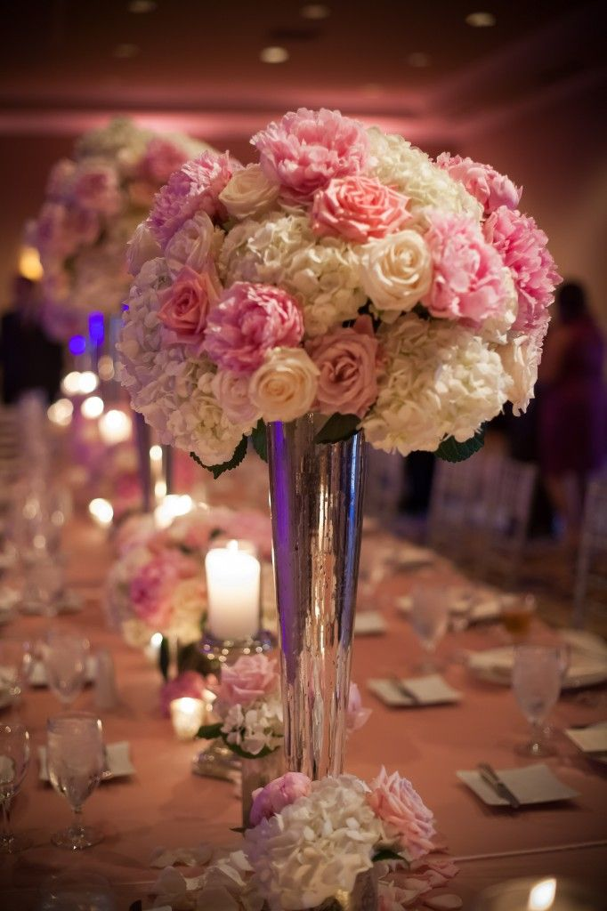 Lush, tall centerpieces-hydrangea , roses and pink peonies in mercury glass.