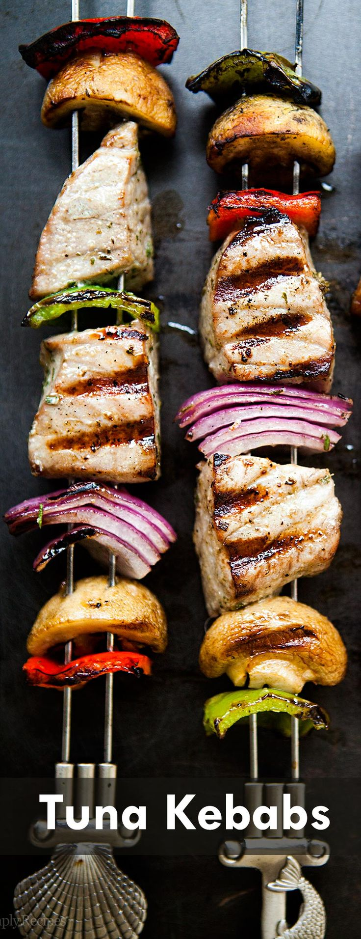 Get your grill on with tuna kabobs! skewers of marinated fresh tuna, onions, bell peppers, and mushrooms. On SimplyRecipes.com #paleo #healthy #glutenfree