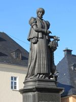Barbara Uthmann statue in market place Erzgebirge,Germany.  - According to legend,she introduced bobbin lacemaking into the Erzgebirge, Germany and invented the bolster-shaped lace pillow which is typically used there.