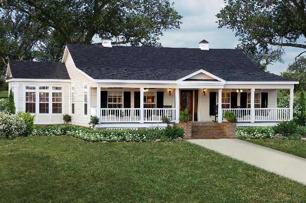 Modular homes exterior..i love the front porch and brick skirting...don't like the black shutters.