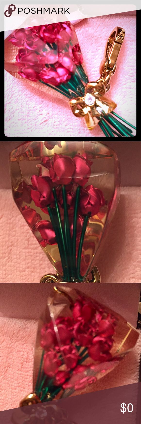 Juicy Couture Charm Juicy Couture 🌹 Bouchée of Roses. This is one of the bigger charms and has tons of detail. The roses are encased in plexiglass and has a 💎 stone in the bow. Stems hang out and are flexible. Not for sale, just sharing from my personal collection. Juicy Couture Jewelry