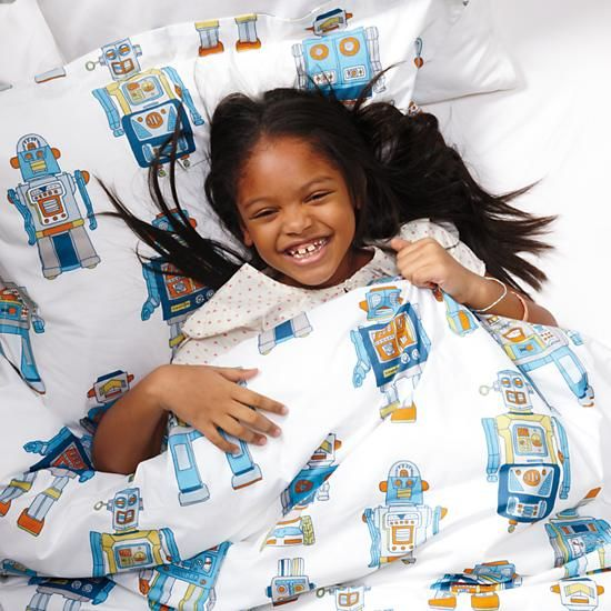 It's alive! After countless hours of tinkering around in The Land of Nod merchandising department, we've brought our robot sheets to life. Our printed robot kids bedding features an army of blue, green, orange and silver marching robots.