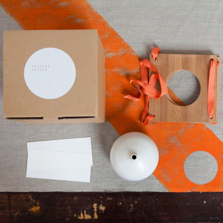 Stoneware Promise Keeper with satin white glaze, hand printed orange orange raw linen furoshiki, carbonized bamboo frame and stone white note paper.  Promise Keeper D13cm H12cm.  Furoshiki 65cm x 65cm Box 20cm x 20cm   Each piece is hand made so individual variations may occur.  Free Postage any where in Australia.