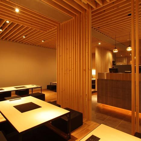 Kurogane by Maker:  Japanese architects Maker have completed a Hiroshima restaurant where timber slats on the ceiling descend around the dining tables.