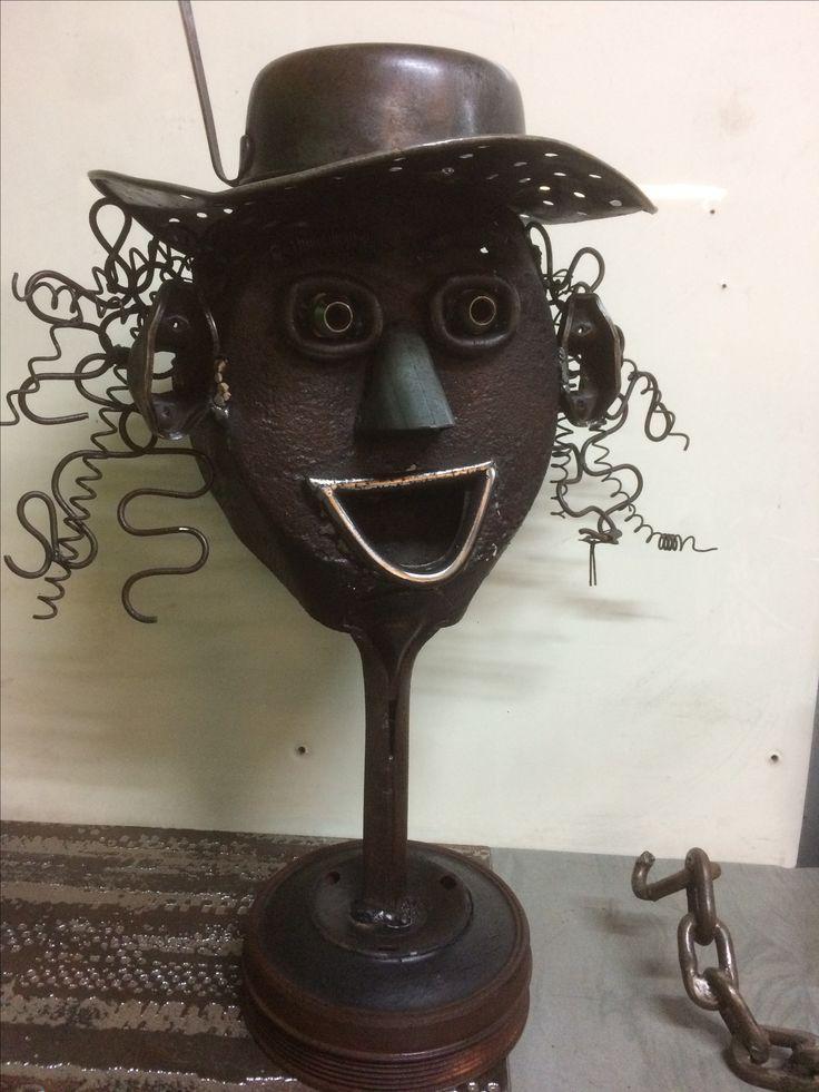 Garden art face metal sculpture made from recycled scrap metal