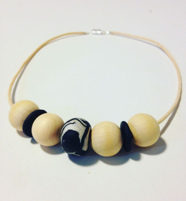 A monochrome mix of hand made marbled fimo beads mixed with wooden beads & natural waxed cord - my very first necklace
