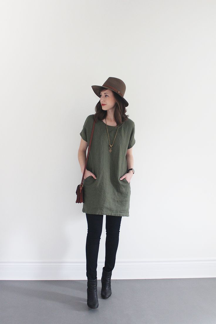 olive tunic pullover/wool dress, Dordogne taupe cap, black skinny jeans/tights, black booties
