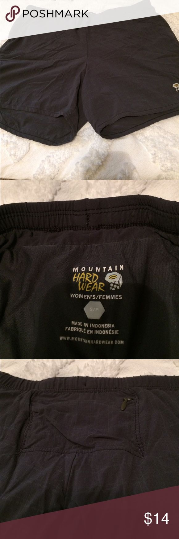 Mountain Hard Ware running/hiking shorts Grey lightweight shorts with built in undergarment. Small zipper pocket in back. Good condition and perfect for the outdoors! Mountain Hard Wear Shorts
