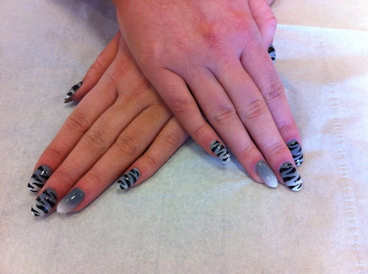 A set of acrylics I did with free hand zebra print over colour blended air brushing