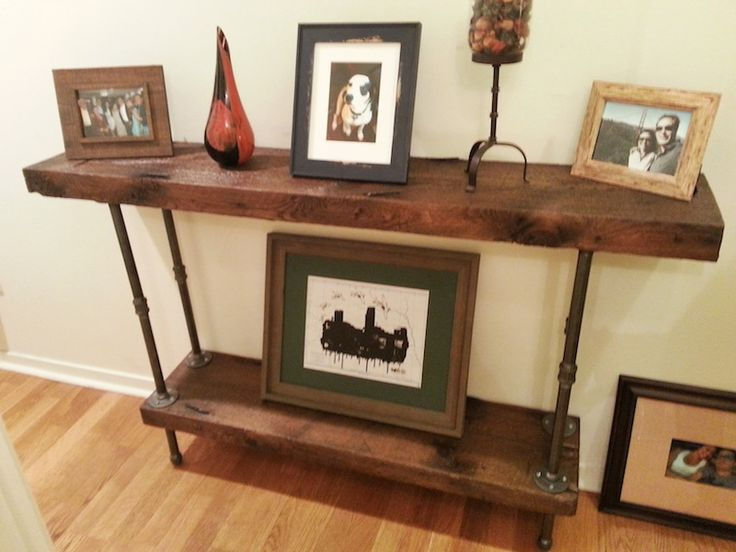 Console table built out of reclaimed lumber and black steel pipe