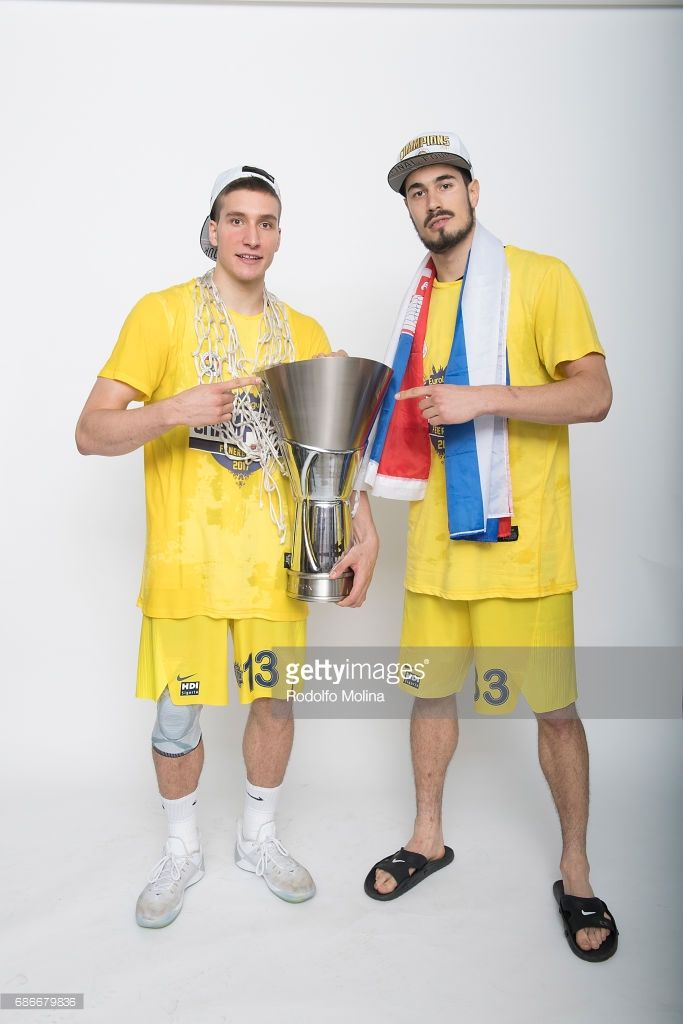 Bogdan Bogdanovic, #13 of Fenerbahce Istanbul and Nikola Kalinic,Ê#33 pose with Trophy during Turkish Airlines EuroLeague Basketball Final Four istanbul 2017 Champion Photo Session at Sinan Erdem Dome on May 21, 2017 in Istanbul, Turkey.