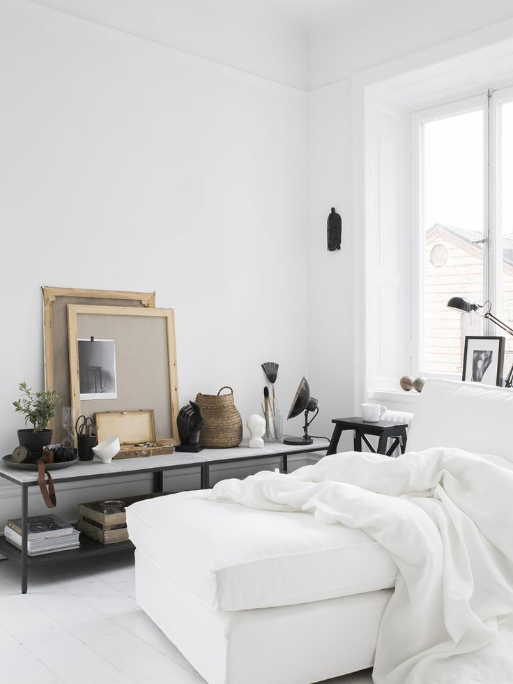 white chaise by the window for a cozy reading spot