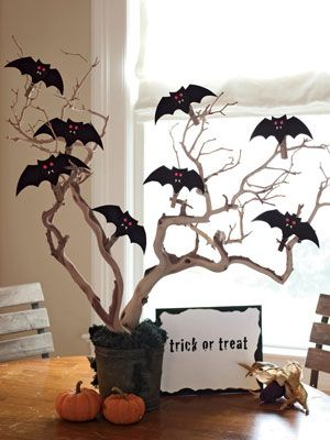Create this Batty Centerpiece with black and dark brown construction paper (trace our bat pattern in the back of the book or draw freehand). Use a hole punch and bright orange paper to make the eyes; make fangs from white paper. Attach t - WomansDay.com