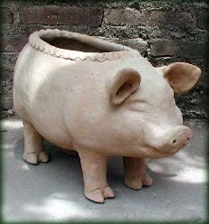 This Big Pig From The Great Green Apple Is Your Guard Pig. He Is Sturdy And  Heavy, And Will Look Sensational Filled With Flowers.