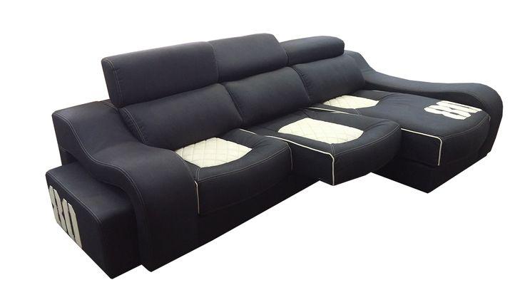 #Sofá con #chaiselongue, asientos deslizantes y pufs en el brazo.