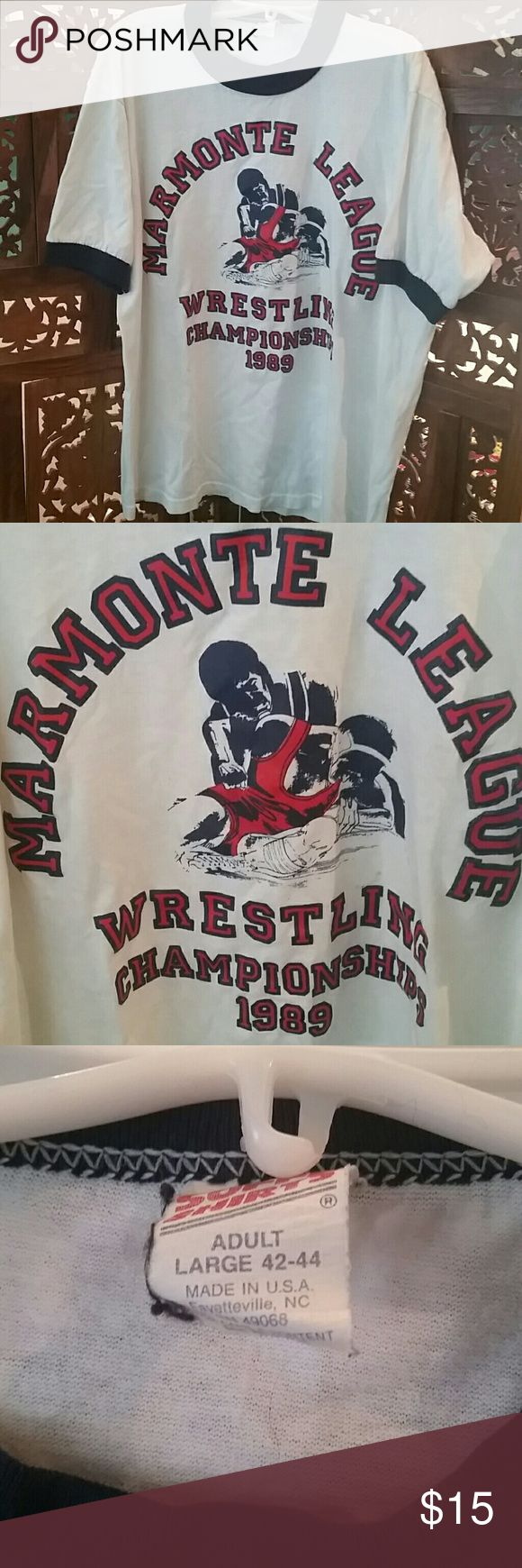 "Vintage 1989 Wrestling Championship Ringer Tee 1989 Marmonte  League Wrestling Championships ringer T-shirt. White with vibrant red and navy blue iron on letters and wrestlers. Marked a large 42-44, but seems smaller. Measures about 18"" flat across chest armpit to armpit and 22.5"" shoulder to hem. Very soft 50% cotton, 50% polyester. Fair to good condition. A few light spots and two small holes at the back left shoulder. Also, I have a black dog whose hair decided to adhere to this shirt…"