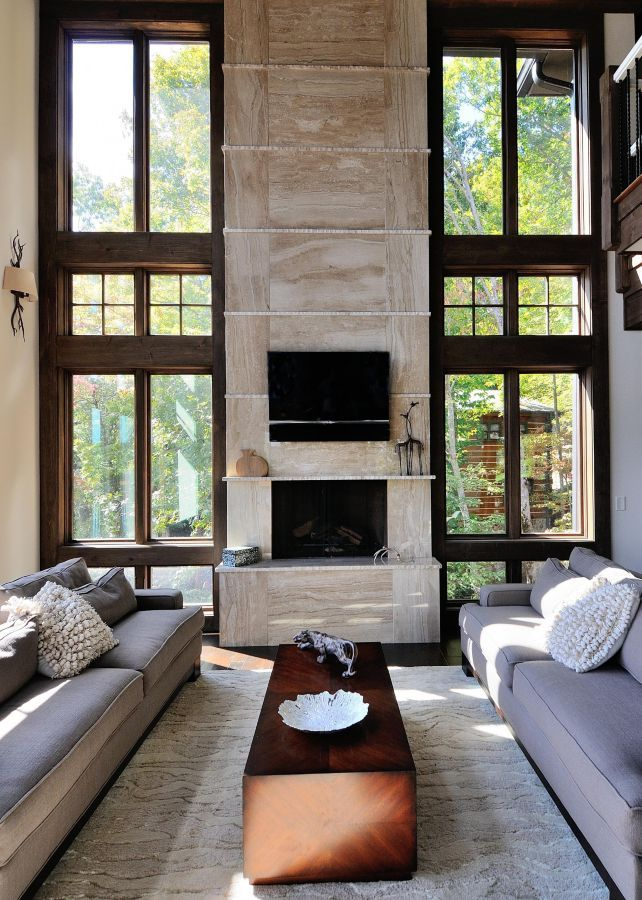 A fireplace completed by @levantinausa steals the show in this cozy living room. #luxeDallas