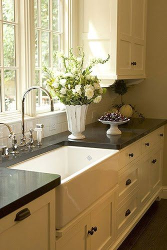 We love white kitchens with dark countertops!