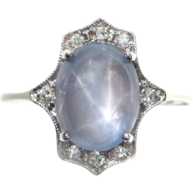 This gorgeous vintage engagement ring boasts a 3.62 carat oval blue star sapphire surrounded by sparkling accent diamonds by gandsco on Ruby Lane.