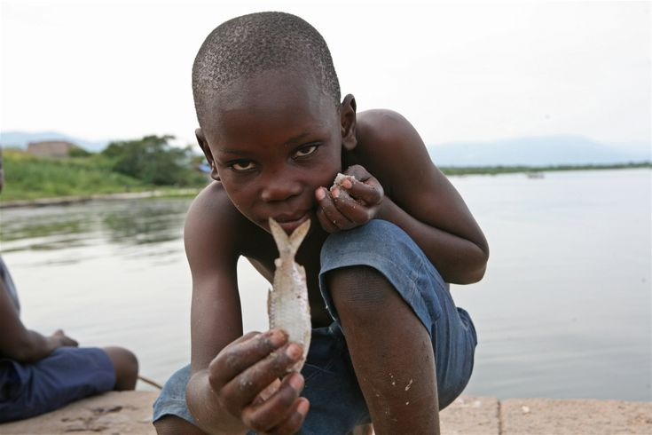 Children in Kasenyi, DRC, begin fishing at a very young age