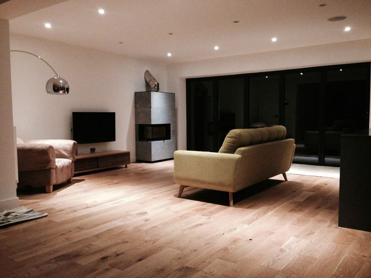 This open plan room has a Contura i41T Woodburner (fitted by Hagley Stoves), Barbican sofa and bifold doors leading to the garden.