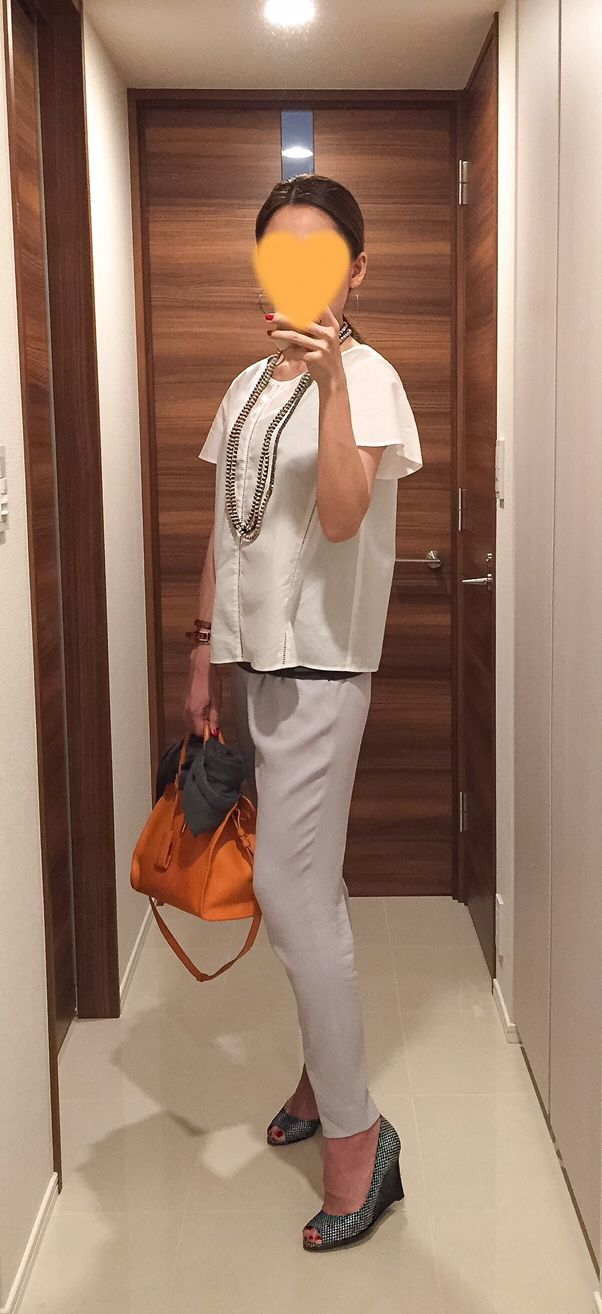 White top: NEW YORKER, Grey pants: Des Pres, Orange bag: Saint Laurent, Wedge sandals: Sergio Rossi
